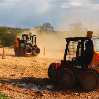 Heading to the finish line dumper truck racing