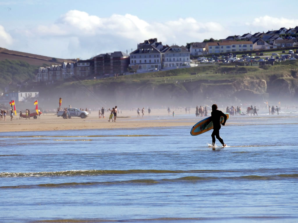 Surfing at Penhale Sands